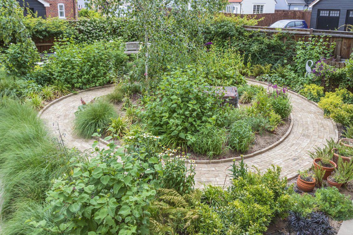 Traditional Garden Bradfield Essex. Design and Build Cube 1994. Unfurling path