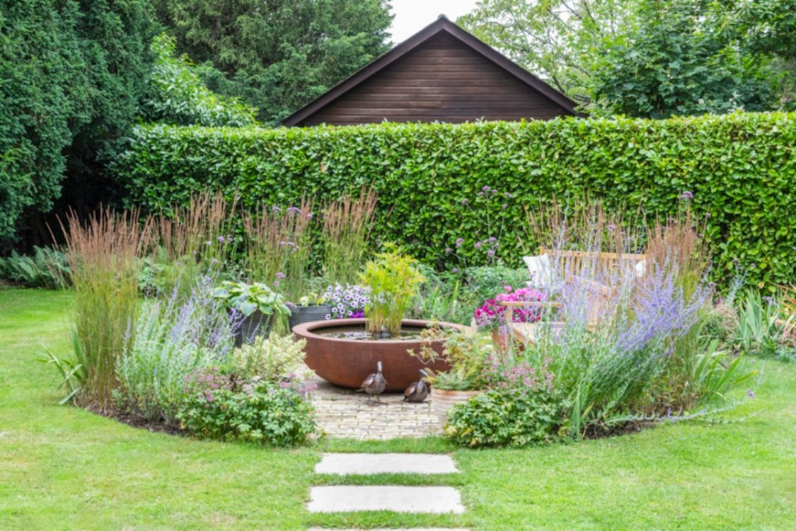 Contemporary View, Chelmsford Essex. Design and Build Cube 1994 Ltd. Urbis Bowl, woodland planting, stepping stone path